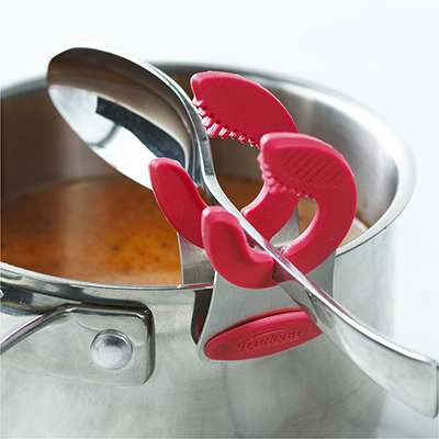 <BR>Fente intégrée pour les ustensiles à manche plat<BR>